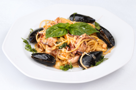 Seafood pasta with basil and parmesan isolated