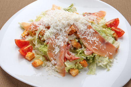 Ham and parmesan salad with tomatoes and croutons