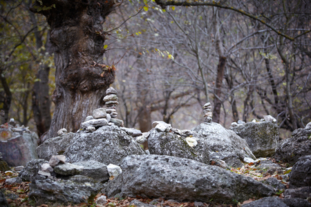 meditaion: Pyramid of rocks in a wood captured at daylight