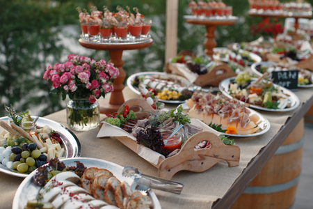 Outdoors fourchette table with italian appetizers and fresh flowers