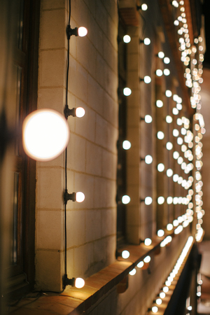 Outdoors christmas building decoration with light bulbs