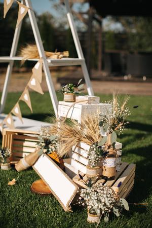 Closeup shot of the rustiс wedding decoration elements  at daylight