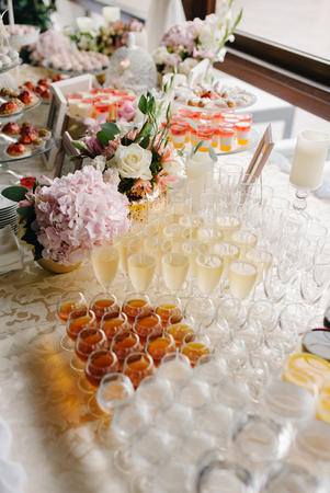 Rows of alcoholic drinks prepared for fourchette