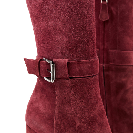 Studio shot of high female red suede leather winter boots