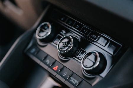 Closeup shot of vehicle interior elements, control buttons