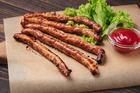 Grilled sausages with ketchup Standard-Bild