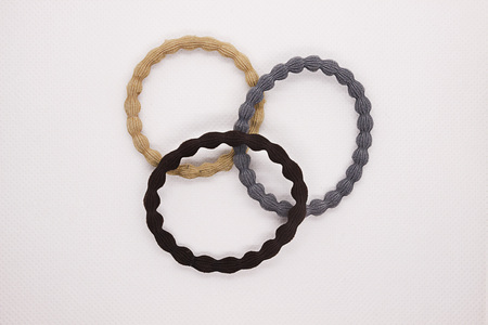 Hair accessories. Three hair ties on a white background