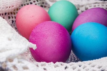 Colored Easter eggs on a white lace napkin Reklamní fotografie
