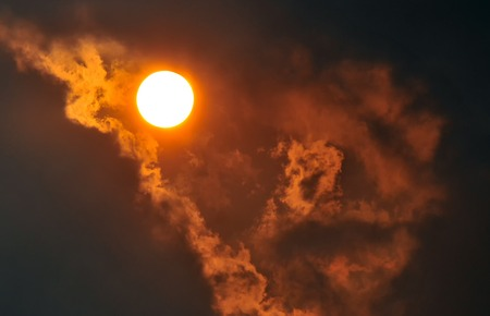 The sun . in the clouds