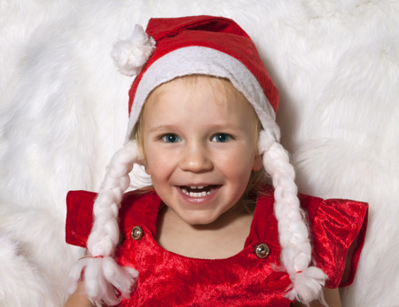 little child with christmas hat photo