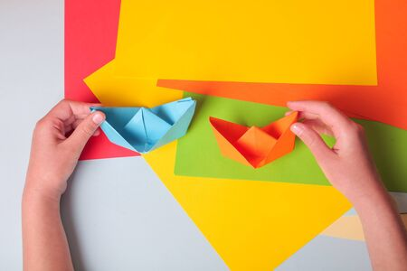 Step by step photo instruction. How to make origami paper little boat. DIY for children. Children's art project craft for kids.