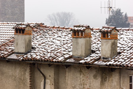 cement chimney: Three concrete chimneys and brick with ridge tiles, covering by snow