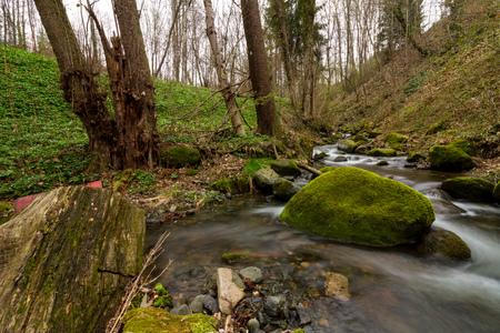 little creek scenery with metal bin in long exposure Stock Photo