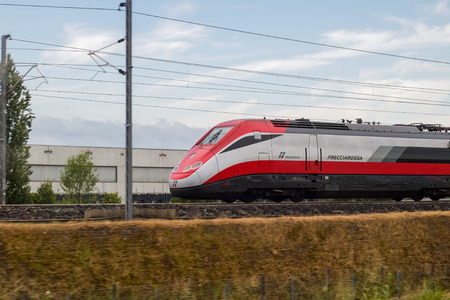 Novara, Italy -June 25, 2017: High speed train ride in motion. Italian Frecciarossa running to Milan. Editorial Photo