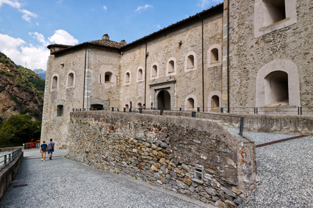 Fort Bard, Valle dAosta, Italy - August 18, 2017: Historic military construction defence Fort Bard. Touristic medieval fortress in Italian Alps. Location of the Avengers: Age of Ultron film. Editorial