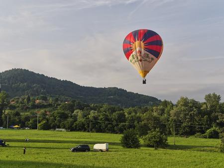 Biella, Italy, June 10, 2018 - A balloon flight in the blue Sky at the spring festival, June Pollone dal Cielo, Biella