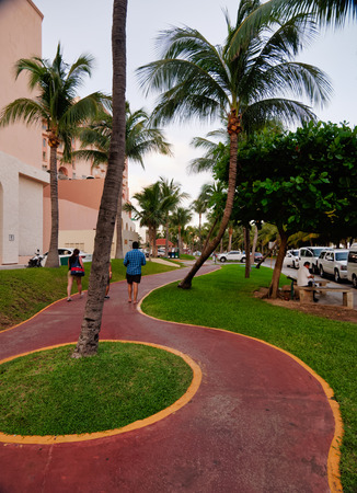 Footpath with palm trees between resort, Kukulcan Boulevard, Zona Hotelera, Cancn, Mexico, in September 8, 2018