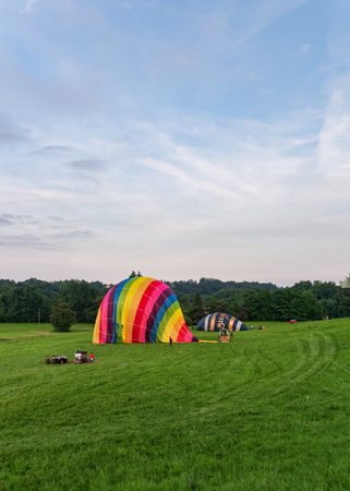 Biella, Italy, June 10, 2018 -Two hot air balloons being anchored and deflated after the flight at spring festival, June Pollone dal Cielo, Biella