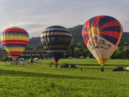 Biella, Italy, June 10, 2018 - Three beautiful and colour hot air balloons at the spring festival, Pollone dal Cielo, Biella