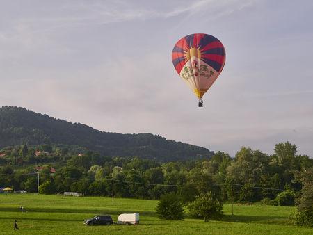 Biella, Italy, June 10, 2018 - A one balloon flight in the blue Sky at the spring festival, June Pollone dal Cielo, Biella