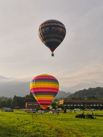 Biella, Italy, June 10, 2018 - Two beautiful and colorful hot air balloons at the spring festival, Pollone dal Cielo, Biella