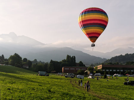 Biella, Italy, June 10, 2018 - Beautiful and colorful hot air balloon flying over people at spring festival, June Pollone dal Cielo, Biella Editorial