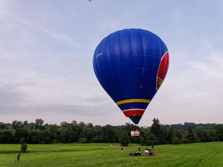 Biella, Italy, June 10, 2018 -Air balloon in flight in phase of landing at the spring festival, June Pollone dal Cielo, Biella