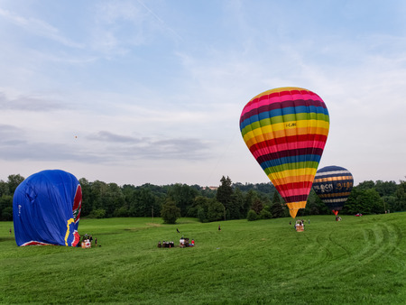 Biella, Italy, June 10, 2018 -Three hot air balloons being anchored and deflated after the flight at spring festival, June Pollone dal Cielo, Biella Editorial