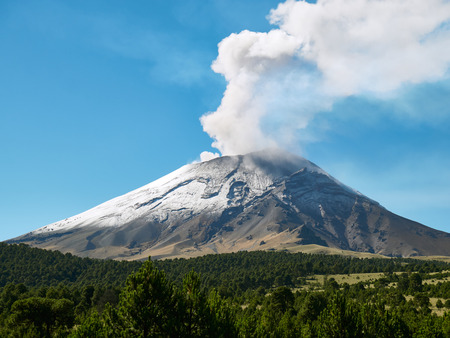 Fumarole comes out from the crater Popocatepetl volcano seen from Itza-Popo National Park, Mexico