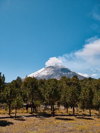 Popocatepetl volcano with fumarole comes out seen from Itza-Popo National Park, Mexico Banco de Imagens