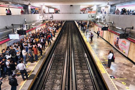 People wait for metro in station of Mexico City