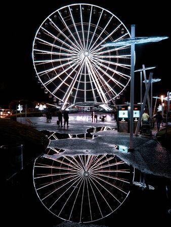 Ferris wheel Estrella de Puebla with reflection on the water