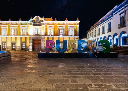 Giant letters of Puebla in Main Theater square at night