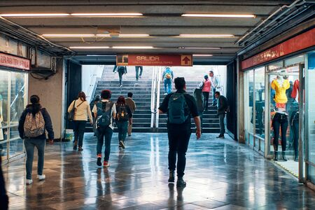 Commuters walking to metro exit in Mexico City