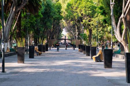 Urban park Paseo Bravo in Puebla with very few people in quarantine period for Covid-19, Puebla de Zaragoza, Mexico, in April 9, 2020.