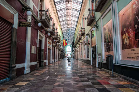 Shopping gallery Pasaje del Ayuntamiento (City Hall passage) with closed shops and hotel for coronavirus contingency, Puebla, Mexico, in April 24, 2020
