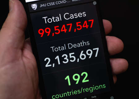 Crop anonymous person view coronavisrus total positive cases in COVID-19 Dashboard on modern mobile phone, Mexico, in January 25, 2021