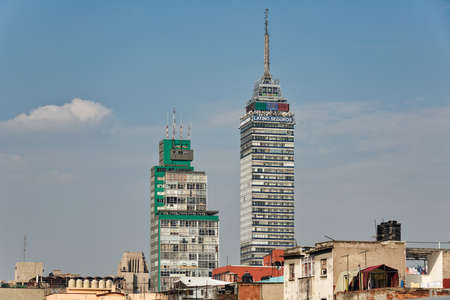 Exterior of high rise building Latin American Tower or Torre Latinoamericana situated in downtown of Mexico City against blue sky, Mexico, in January 25, 2021 新闻类图片