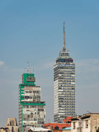 Exterior of high rise building Latin American Tower or Torre Latinoamericana situated in center of Mexico City against blue sky with clouds, Mexico, in January 25, 2021