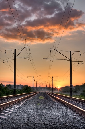 black train: Railway way on sunset of a sun Stock Photo