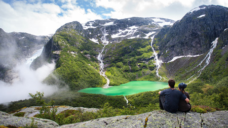Couple in embrace of the Norwegian mountains photo