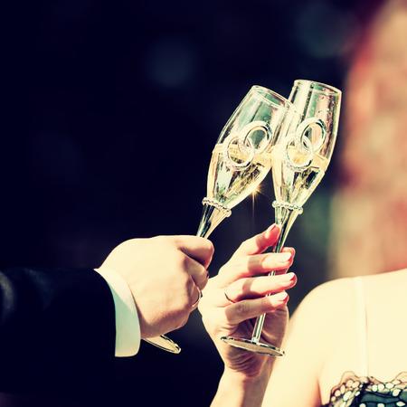 Celebratory glass of champagne in hand of bride,vintage Zdjęcie Seryjne