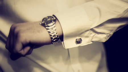 wealth: Cufflinks on a shirt Groom, vintage Stock Photo