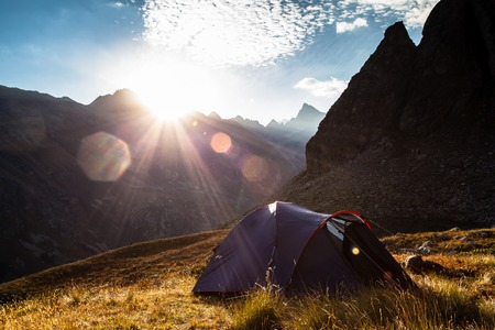 Sunrise in the mountains and the tent