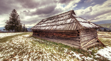 Old abandoned wooden house in Carpathians, hdr