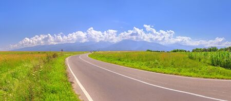Road and mountain range Fegerash, Romania. Panorama, high resolution Foto de archivo - 150029964