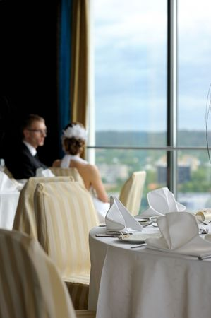Groom and bride in the cafe looking at the city through the window Stock Photo