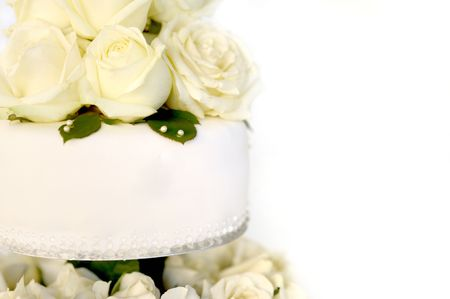 White cake with a bunch of yellow roses on the top Stock Photo