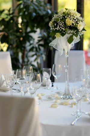 Table set for a festive party or dinner with a yellow rose Stock Photo