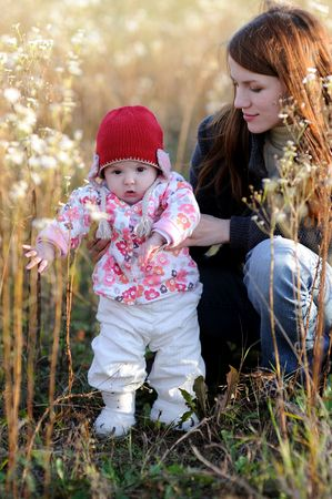 Young mother with her little baby in a meadow Stock Photo - 5533309